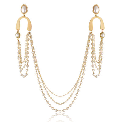 Three pearly chains cascade going from ear to ear creating a very chic earlace, made of pearls and gold U shape motif, cast to an oval pearl stud. Whether you have short hair or long hair that you wear up, this earlace is an accessory that always catches attention.