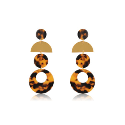Add a classic touch to any outfit by wearing these on-trend brown tortoiseshell earrings. Geometric gold and Tortoiseshell Drop Earrings are a perfectly trendy look that's never going out of style! These chic earrings feature three circle charms shaped from tartarooga print plexi and a mat 24K gold-plated semi-circle. They are lightweight, durable and suitable to wear from day through the night.