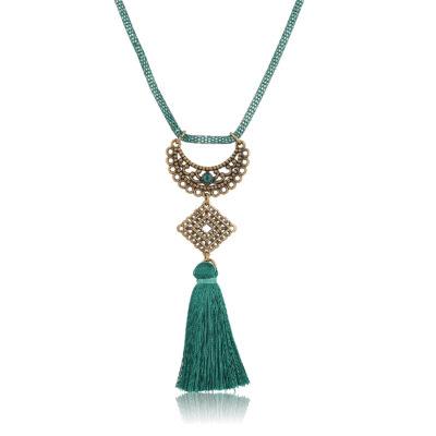 Semi mandala pendant with green tassel
