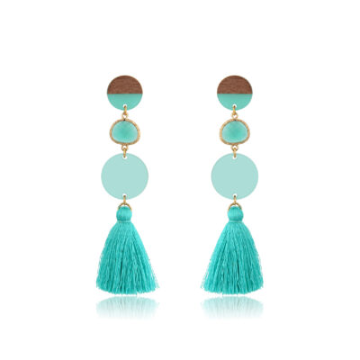 Rosewood and plexi combination creating a chic and sleek tassel earrings. A round stud, a crystal and a plexi disk ending with a long mint tassel, creating a fun and fringy look. Because they're so light, they offer you the comfort you look for in a jewelry. Add the perfect minimalist touch to any outfit with these eco-friendly earrings.