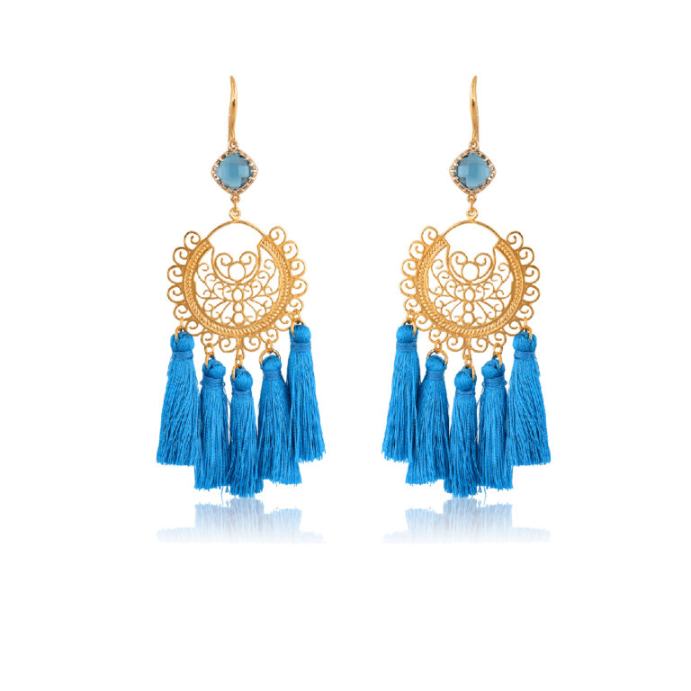 So chic boho earrings. Made with blue little silk tassels. A beautifully made filigree motif, attachedto a blue diamond-shape crystal, dangling from a 24K Gold-plated hook. This pair is perfect for adding a Bohemian touch to your most sophisticated looks.