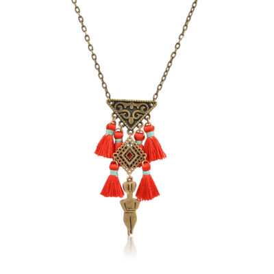 Inspired by the ancient Greek Cycladic figurines, this necklace is a unique jewelry. It's a symbol of fertility and femininity. The filigree triangle represents the women genitalia. Because of its tiny red pompoms, this necklace really pop out on any outfit.