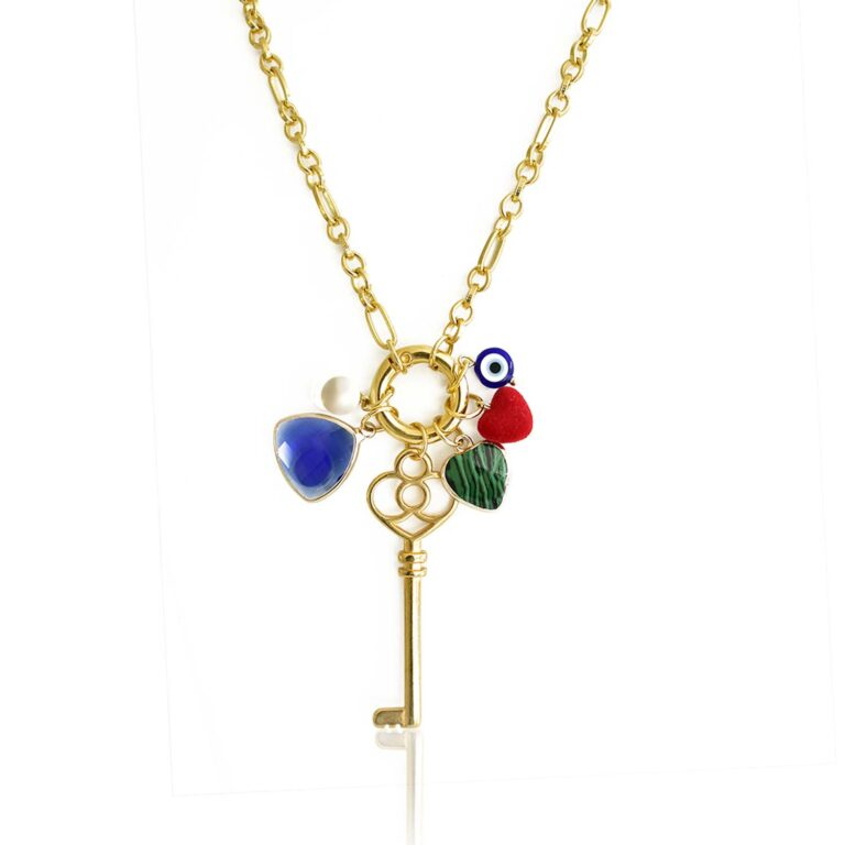 Protect yourself with this splendid necklace! Get yourself seduced by this conspicuous lucky key pendant. This unique piece of jewelry is a powerful talisman and is here to bring you luck. Made of high-quality 24k gold-plated brass, his stainless-steel chain is giving it a special value. The charms surrounding the key are there to reinforce his power. The stones in different tones are creating a tempting color combination. Wear this key pendant with any minimalist Anamae necklace to attract good vibes and open doors to happiness.