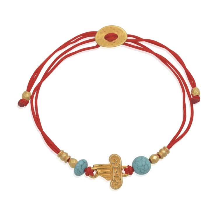"""Adjustable red bracelet with Ionic column. 24k gold-plated and turquoise beads. The textured column is made of 24k gold-plated brass. Whether as a souvenir, a reminder of a special moment, or a vacation spent in Greece, this Greek-chic bracelet is an ideal gift. Perfect to complete any Greek-chic outfit. Combine it, with our other jewelry from our """"Red Sea"""" or """"All Greek to me"""" collections."""